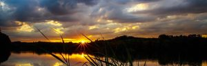 Sunset over a serene lake